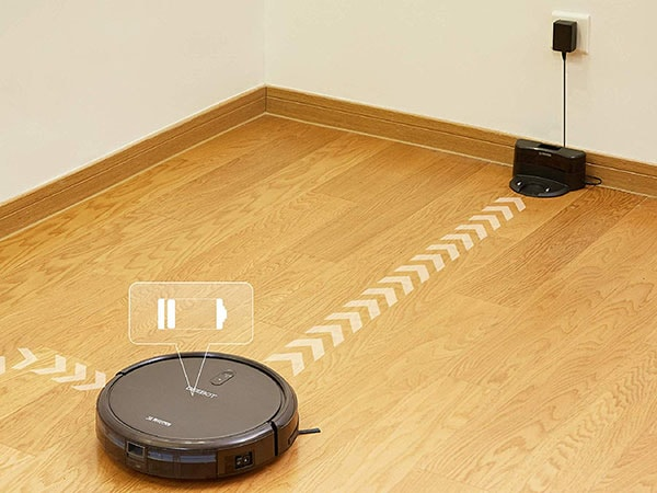 A robovac navigating to its charging base.